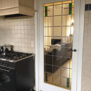 Brandglass Zwolle maakt suitedeuren voor boerderij in Noordeinde Nederland